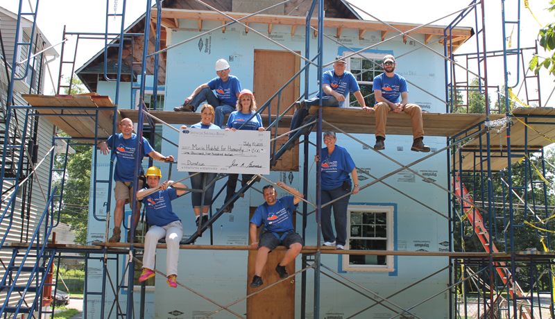 Spencer Savings Bank Donates Money and Volunteer Labor To Help Build Homes in Morris County