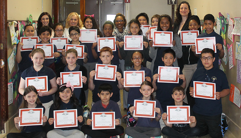 Garfield fifth graders receive everfi certificates from spencer savings bank