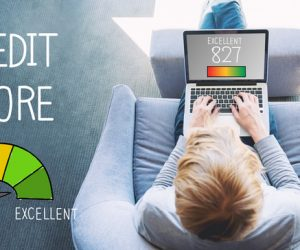 Excellent Credit Score with man using a laptop